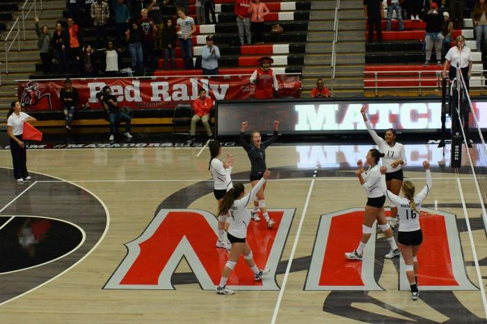 The CSUN women's volleyball team celebrates after defeating the California State University, Fullerton Titans in straight sets. Photo credit: Alejandro Aranda