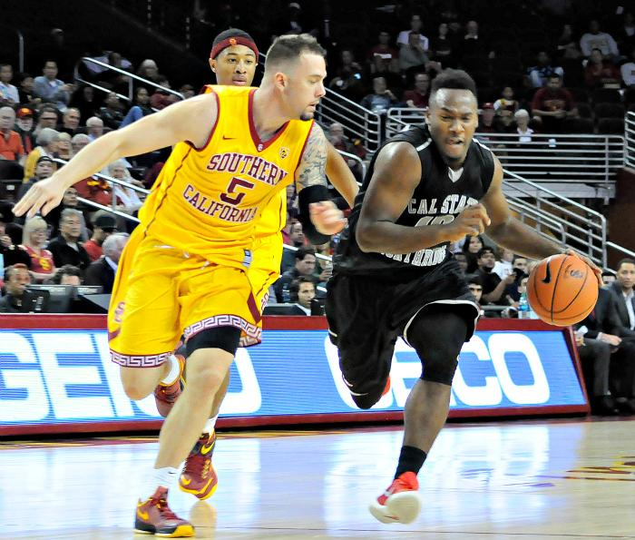CSUN freshman guard Jason Richardson takes on USC junior guard Katin Reindhardt as the Matadors faced the Trojans at the Galen Center on Nov. 23. Richardson would tally a team-high 18 points in CSUN's 96-61 loss against USC.