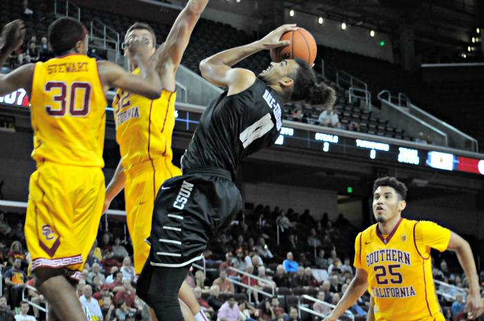 CSUN senior Tre Hale-Edmerson (center) goes for the lay-up as the Matadors faced the USC Trojans at the Galen Center on Nov. 23. CSUN lost 96-61 in its fifth non-conference game.