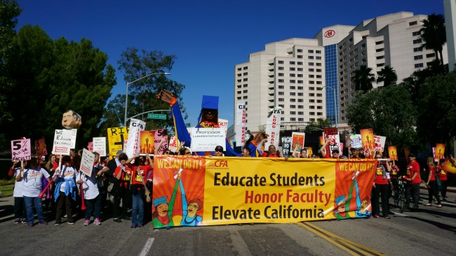 Members and supporters of the California Faculty Association rally through downtown Long Beach on Nov. 17, 2015 for better wages. Photo Credit: Nicollette Ashtiani