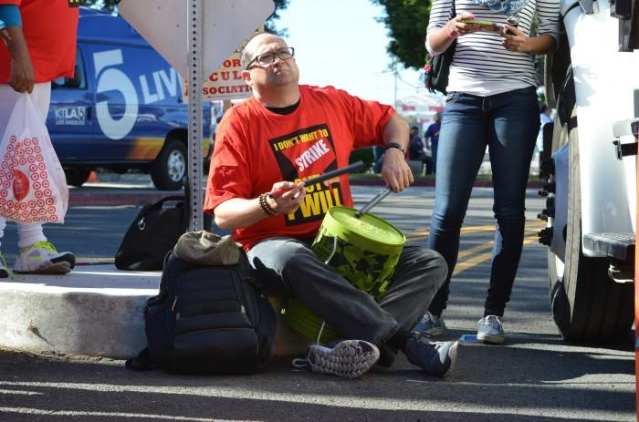CSUN special education professor Ivor Weiner drums along to protest chants at the CFA rally in Long Beach. Nov 17, 2015. Photo Credit: Daniel Shin