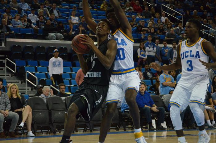 CSUN sophomore guard Micheal Warren drives down the lane against UCLA at the Pauley Pavilion on Nov. 29. Warren led CSUN with nine points as the Matadors lost 77-45 to the Bruins. (Vincent Nguyen / The Sundial)