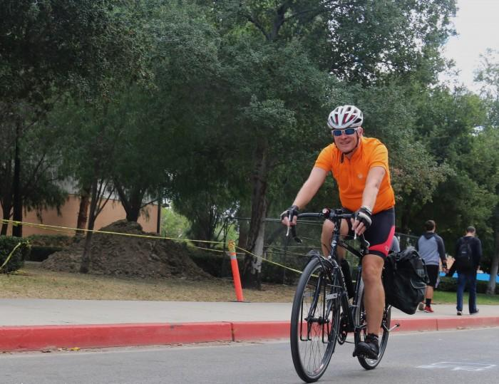 Claude Willey rides his bicycle down Etiwanda at CSUN. Photo credit: Catalina Roldan