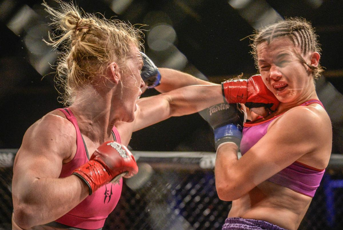Holly Holm, left, delivers a left punch to the face of Brazilian opponent Juliana Wernere during their women's mixed martial arts bout on April 4, 2014 in Albuquerque, N.M. (Roberto E. Rosales/Albuquerque Journal/Zuma Press/TNS)