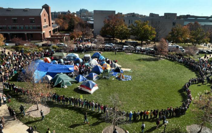 University of Missouri students circle tents on the Carnahan Quadrangle, locking arms to prevent media from entering the space following the resignation of President Timothy W. Wolfe on Monday, Nov. 9, 2015. (Robert Cohen/St. Louis Post-Dispatch/TNS)