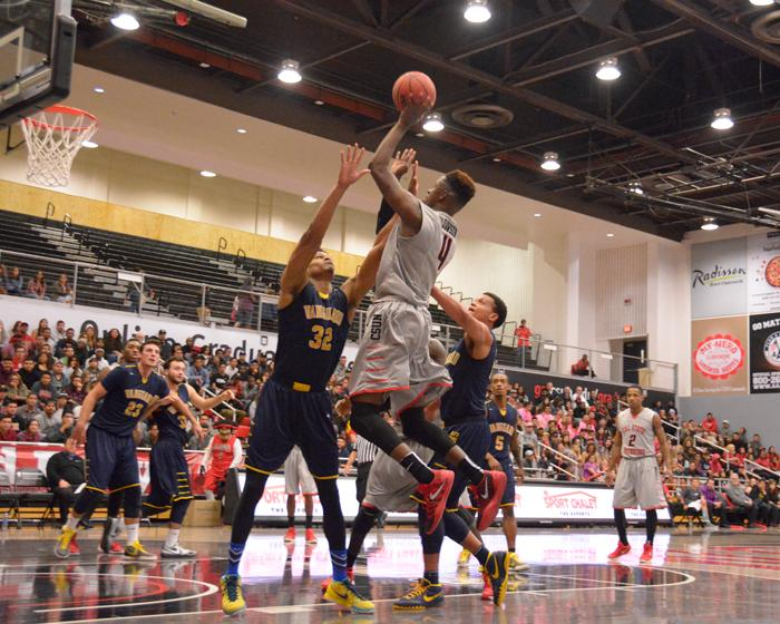 Sophomore Tavrion Dawson goes up for jump shot on the home opener win against the Vanguard lions by a final score of 52-72 at the Matadome on Wendesday, Nov. 18, 2015. Dawson had 10 points in the vicotry. (Raul Martinez / The Sundial)