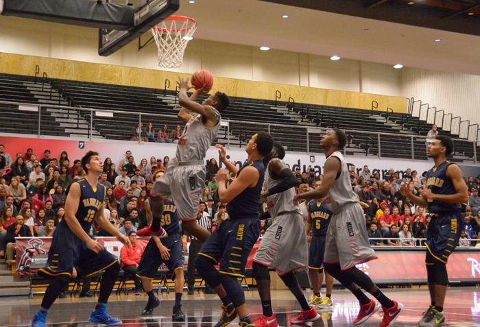 Tavrion Dawson rises up over everyone and scores one of many lay-ups as he would finish the night with 10 points in the home opner win versus Vanguard by a final score of 52-72 at the Matadome on Wednesday, Nov. 18, 2015. (Raul Martinez / The Sundial)