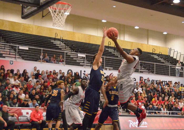 Freshman guard Jason Richardson attempts a layup against Vanguard University on Nov. 18. (Raul Martinez / The Sundial)