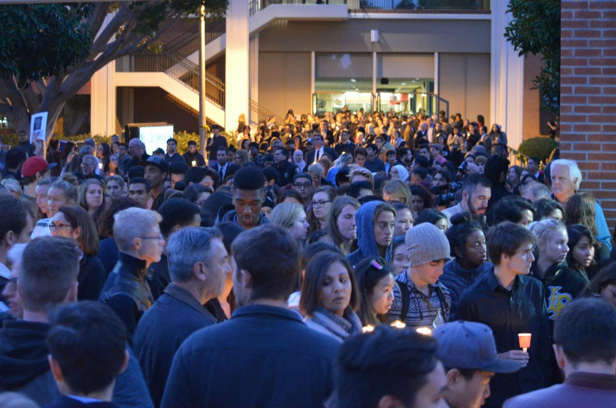 Hundreds of mourners pour out behind CSU Long Beach's University Student Union building for a candlelight vigil. Nov. 15, 2015. Photo credit: Daniel Shin
