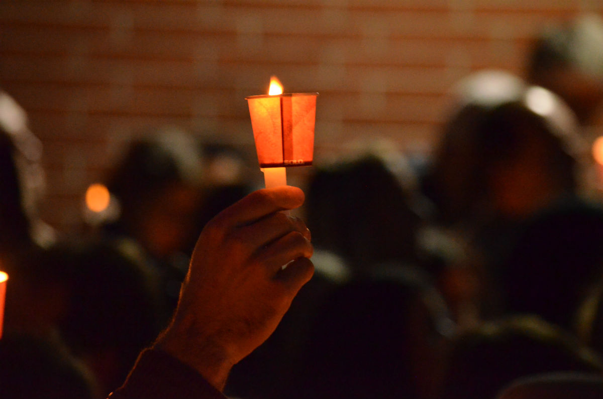 Mourners at CSU Long Beach raise candles in honor of Nohemi Gonzalez's passing. Nov. 15