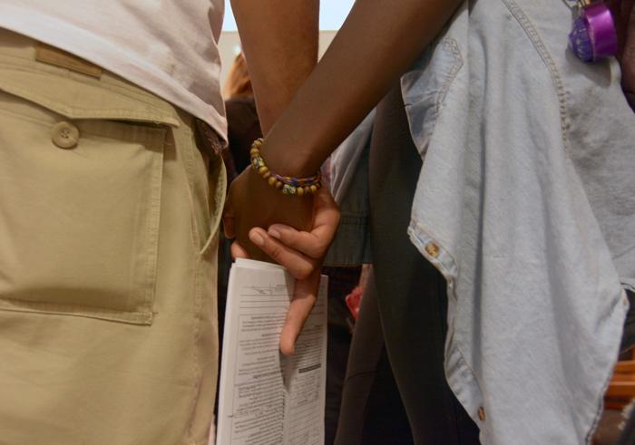 Students hold hands at President Dianne Harris office as CSUN students hand her a letter for a meeting request on Thursday, Nov. 19, 2015. (Raul Martinez / The Sundial)