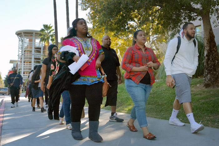 CSUN walk together into President Dianne Harris office to deliver her a letter for a meeting demand on Thursday, Nov. 19, 2015. (Raul Martinez / The Sundial)