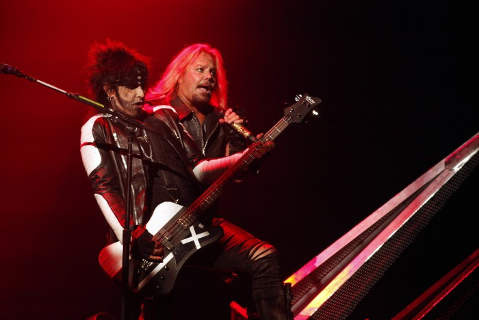 Nikki Sixx, left, and Vince Neil perform with Motley Crue at the Matthew Knight Arena on July 22, 2015 in Eugene, Ore. (Genaro Molina/Los Angeles Times/TNS)
