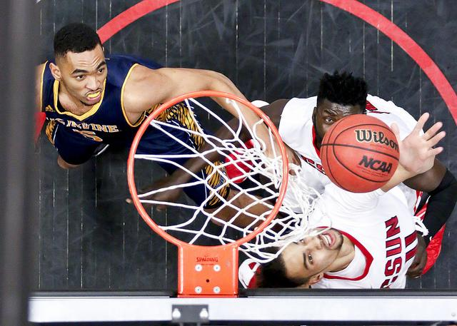 Matadors Tre Hale-Edmerson, right, makes a reverse layup under the basket against the UC Irvine Anteaters which in result of a 63 - 73 loss on Jan. 28, 2016 in Northridge, Calif. (David Hawkins / The Sundial)