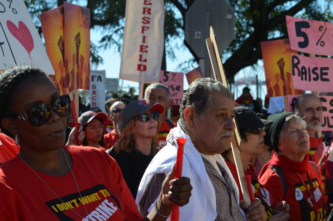 CFA members and supporters listen to speakers at their demonstration in Long Beach on Nov. 17, 2015. Photo Credit: Daniel Shin