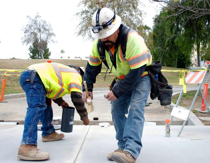 Construction crews hustle to stay on track