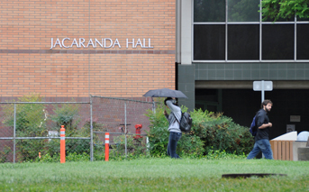 Heavy rain falls in front of Jacaranda Hall. This semester will see plenty of rain due to El Nino year. (File Photo / The Sundial)