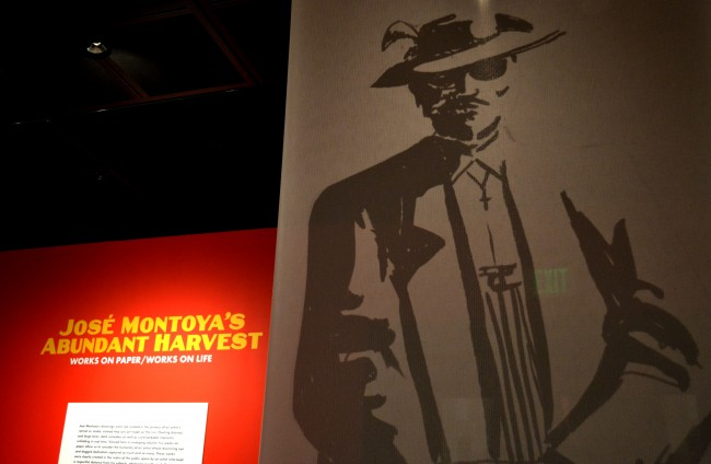 The exhibition's name stands to the side of a large-scaled version of one of Montoya's various Pachuco drawings. (Natalie Jimenez /The Sundial)