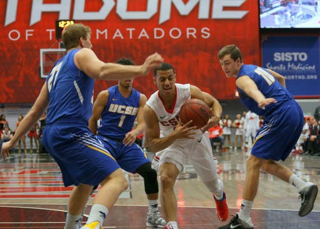 Junior guard Kendall Smith drives past three Gauchos during the first half of Thursday's game, February 25, 2016. The Matadors would lose the game 78-63.