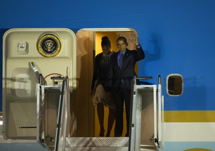 President Obama and first lady Michelle Obama depart Air Force One at San Bernardino International Airport to meet privately with the families of the victims of the San Bernardino terrorist attack, on Friday, Dec. 18, 2015. (Gina Ferazzi/Los Angeles Times/TNS)