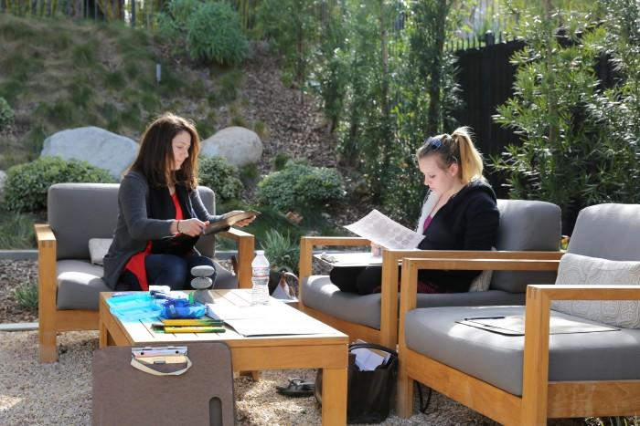 CSUN art faculty Fabia Panjarian instructs art major Richere Barbeau, 21, in the Contemplation Garden of the Oasis Wellness Center, Wednesday, Jan. 27. Panjarian is teaching a series of classes designed to relieve stress and test anxiety for CSUN students. Photo credit: Max Zeronian