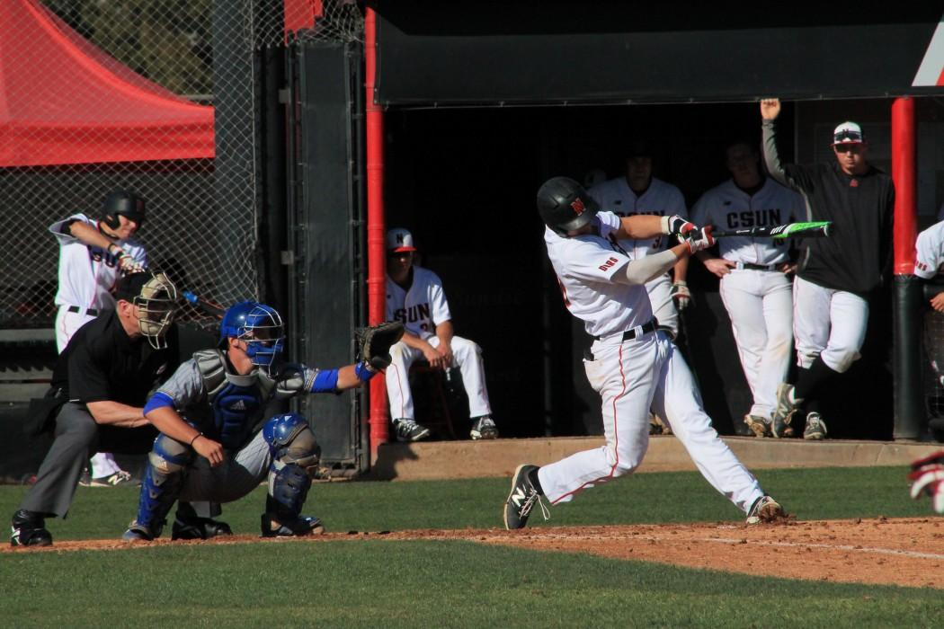 Branden Berry hitting the ball hard against Cal State Bakersfield pitcher during the home opener. (Photo By: Ashley Grant) Photo credit: Ashley Grant