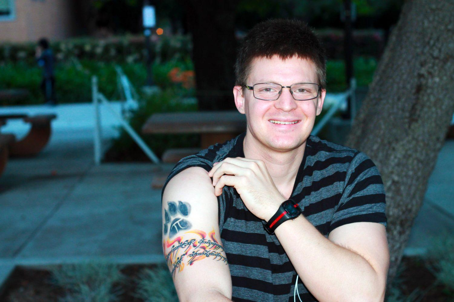 Phillip Charles Smith, 25, is a kinesiology major who found himself not only getting one tattoo, but two in one sitting. (Ashley Grant/ The Sundial) Photo credit: Ashley Grant