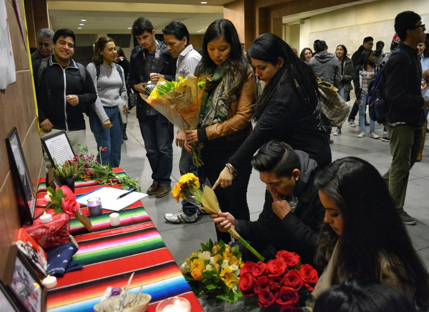 Students stand over altar for Jose Vargas