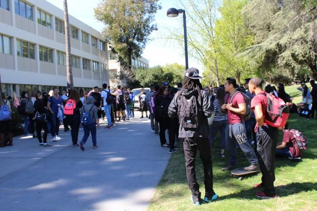 Students wait on Matador Walk after a fire alarm was allegedly pulled Photo credit: James Fike