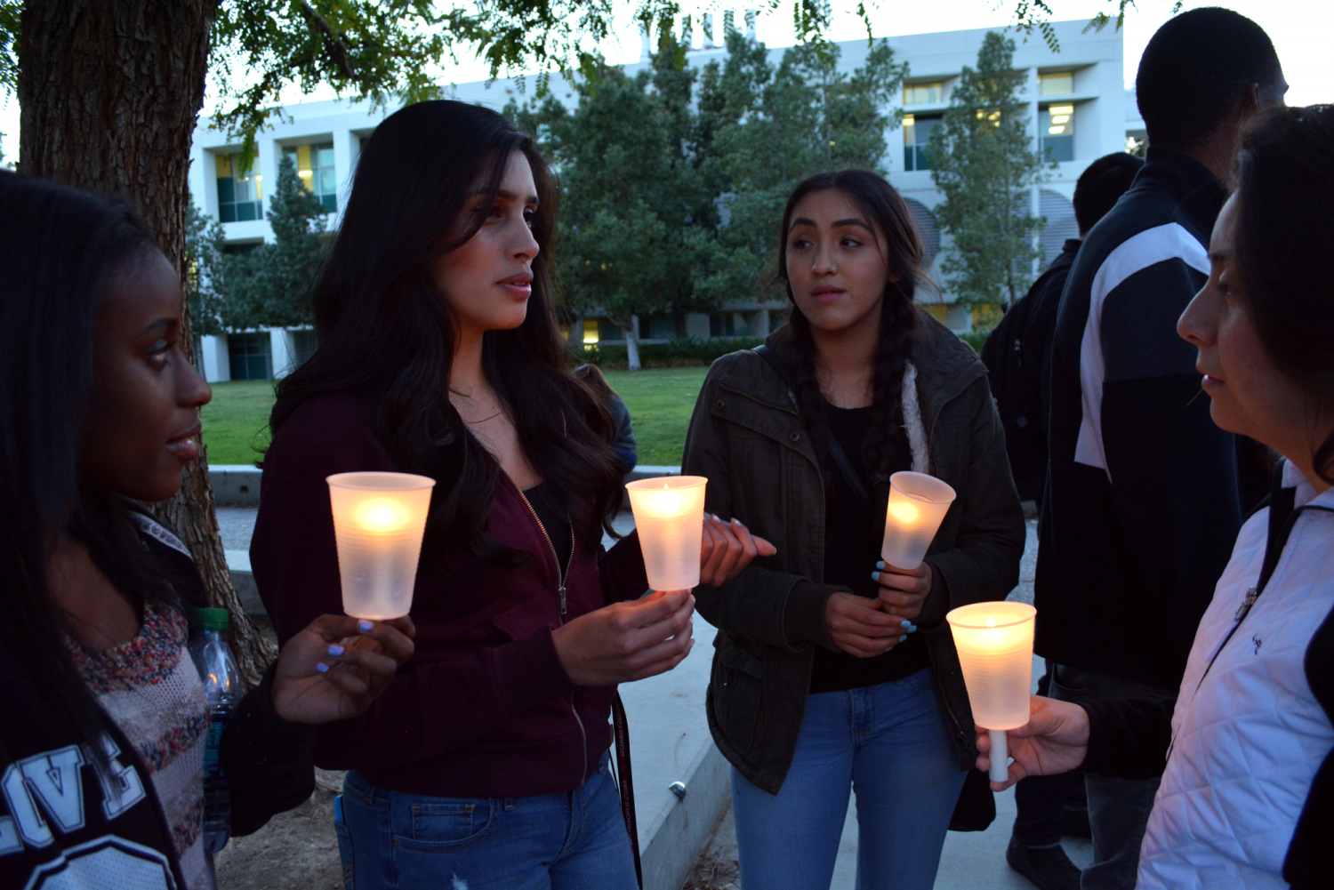 Students carry candles at vigil