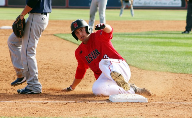 Catcher Dylan Alexander slides into third base in the victory against Northern Colorado. (Jose Aguilar / The Sundail)