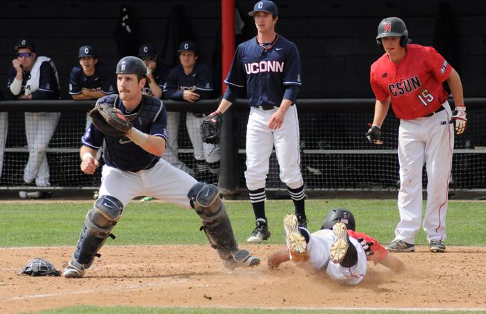 Infielder+Nolan+Bumstead+slides+safely%2C+headfirst%2C+into+home+plate+for+his+only+run+of+the+game+against+UCONN.+Bumstead+had+two+hits+and+two+RBI%27s.+%28Jose+Aguilar+%2F+The+Sundial%29