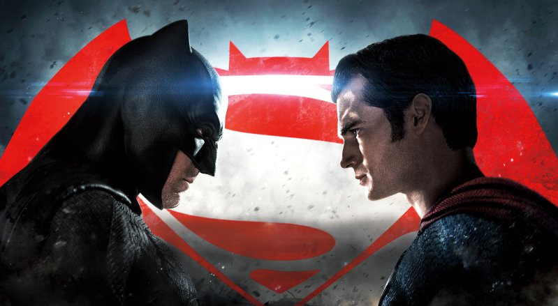 Batman and Superman look at one another in stand off