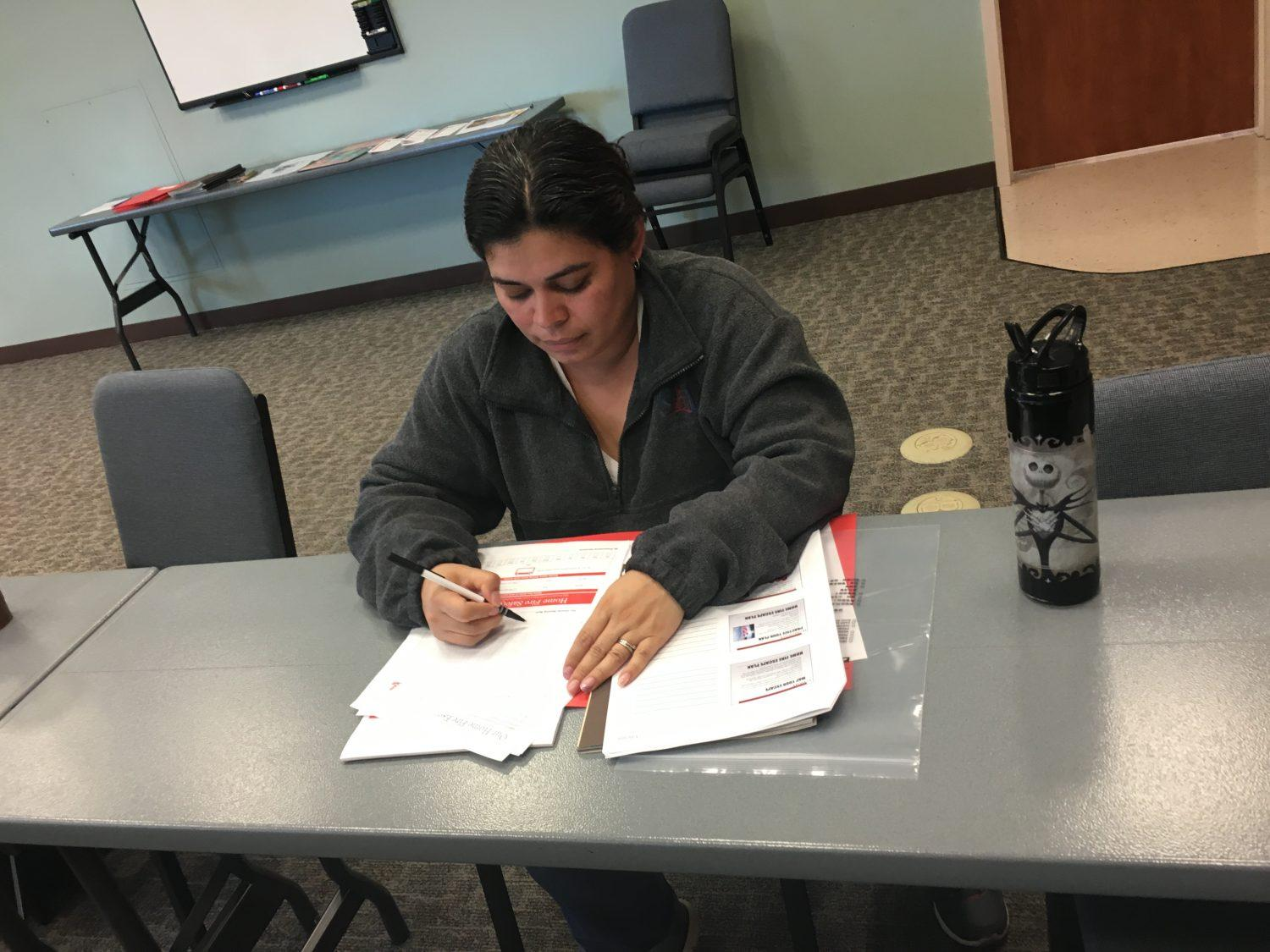 CSUN staff member Veronica Serrano, filling out her home fire safety planner in case of an emergency. Photo credit: Daisy Perez