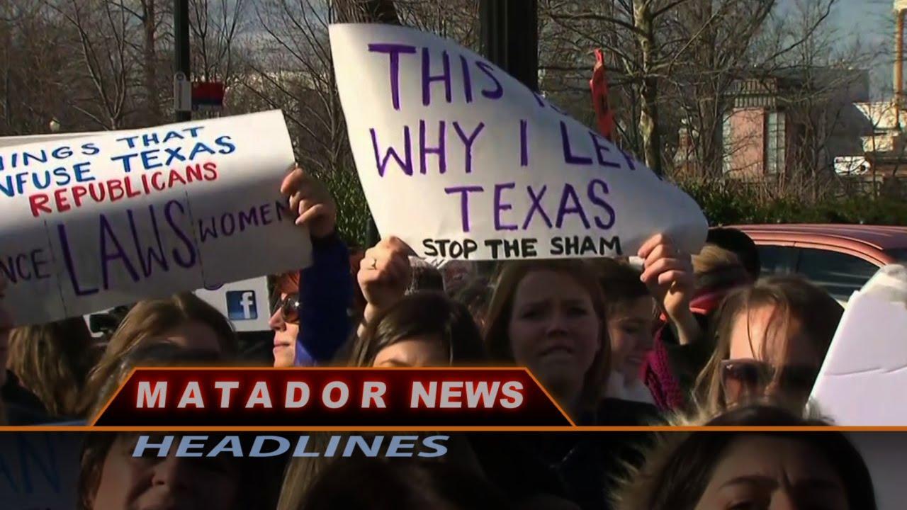 Protestors+hold+signs+from+Matador+News+Headlines