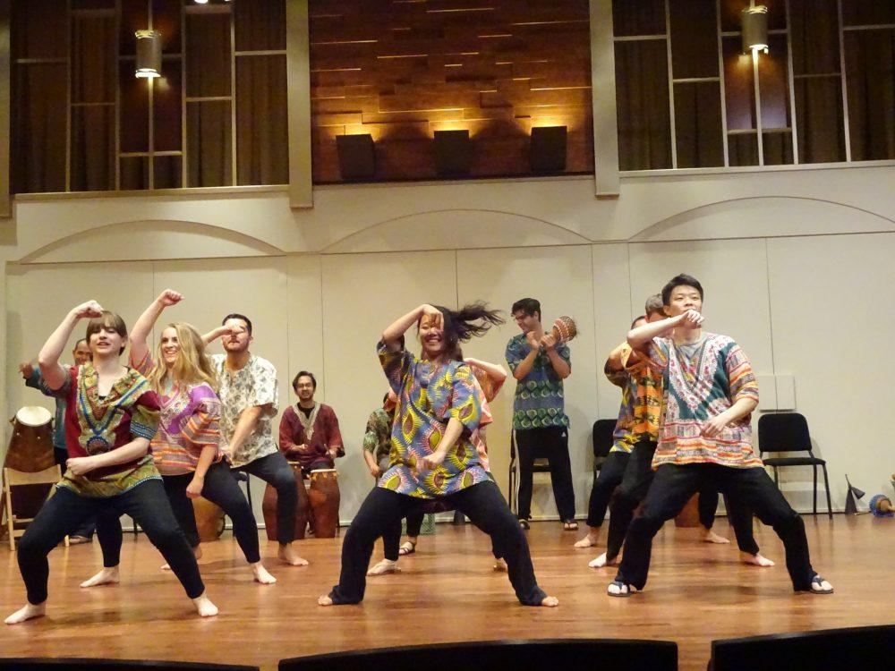 students dance to African music