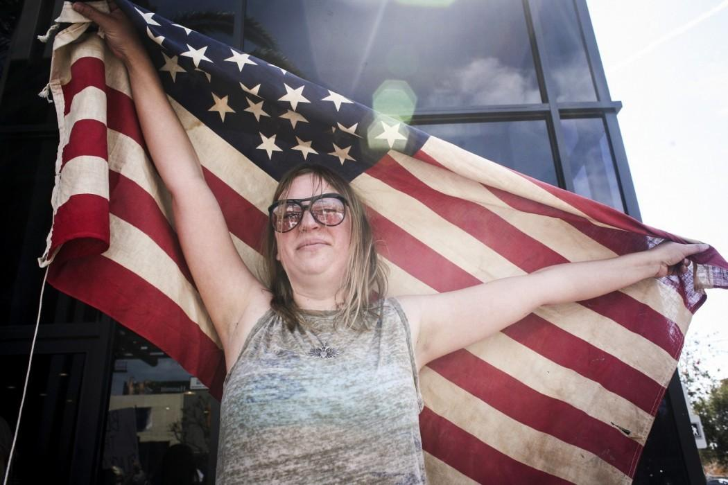 Woman+holds+American+flag