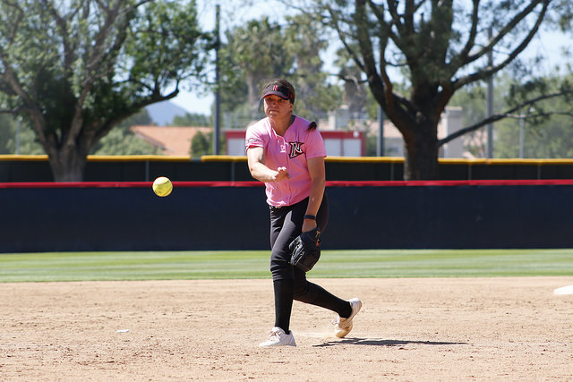 CSUN softball player pitches ball