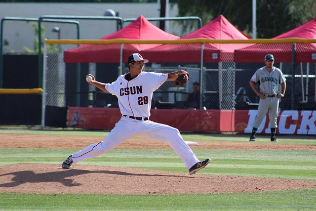 CSUN+athlete+pitches+ball+during+a+game