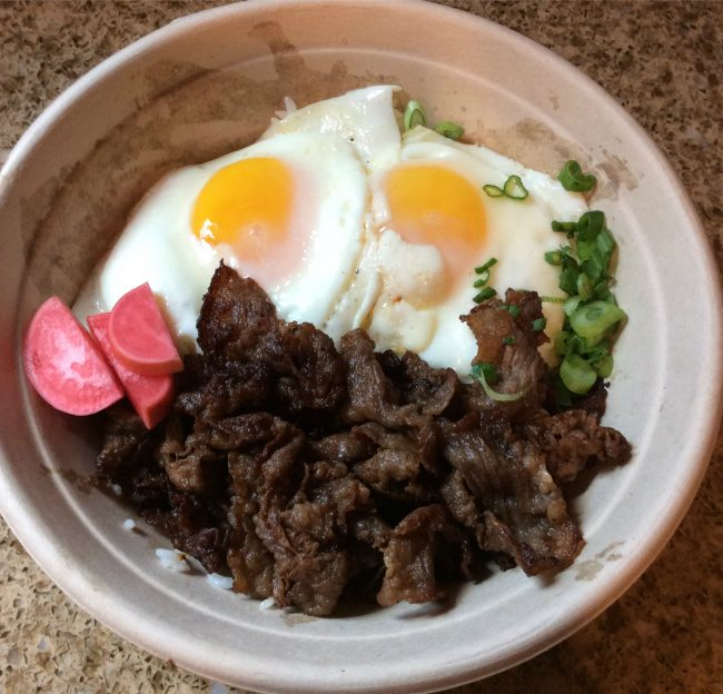 Oi's Adobo Bowl, $8, consists of braised pork belly, adobo sauce, soft boiled egg and scallions. (Genna Gold/The Sundial)