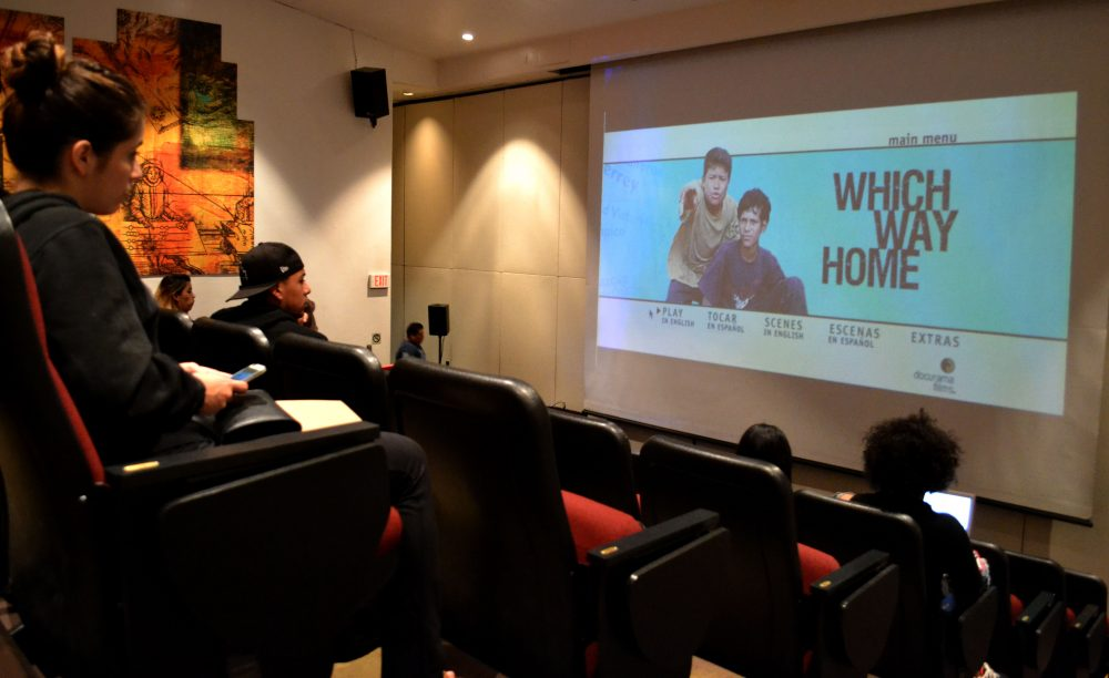 "students sit in theater before ""which way home"" showing"