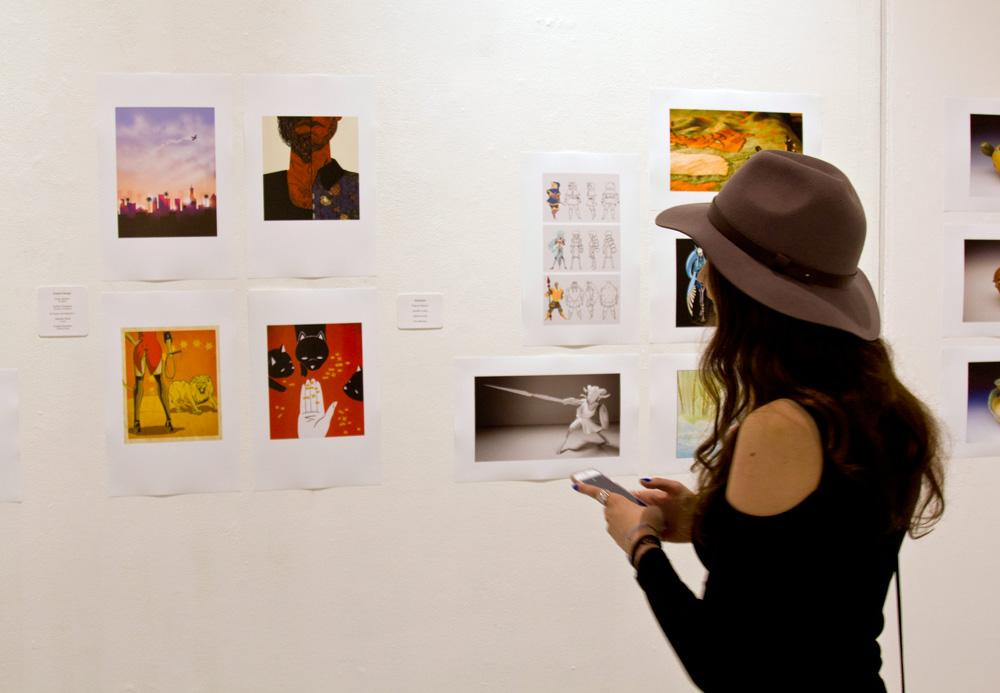CSUN+student+Kristina+Zlatanov+reviews+her+art+pieces.+Zlatanov%27s+artwork+is+on+display+at+CSUN%27s+art+gallery+until+April+27.+Photo+by%3A+Blaise+Scemama