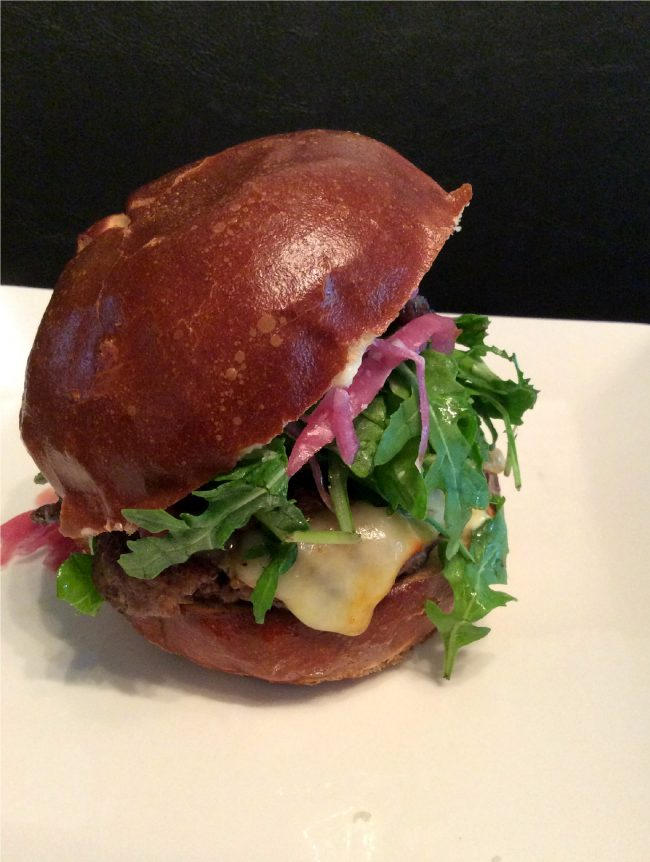 Oi Burger, $9, consists of an angus beef burger, pickled red onions, truffled balsamic shiitake mushrooms, muenster cheese, mayo, arugula and a pretzel bun. (Genna Gold/ The Sundial)
