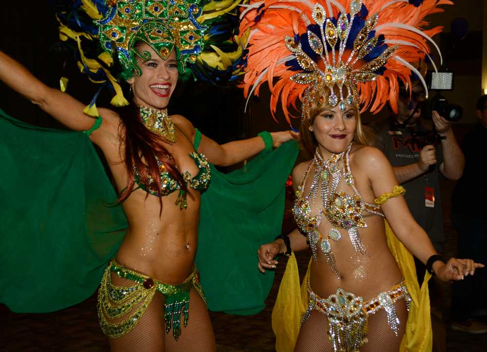Two women carnival dancers pose for camera
