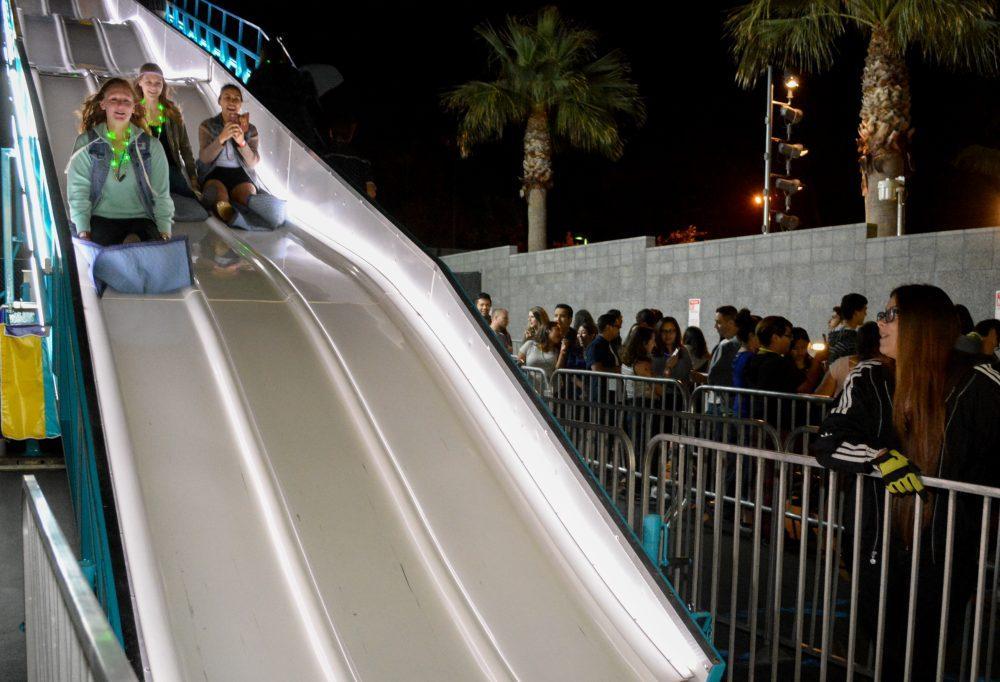 Students slide down giant slide