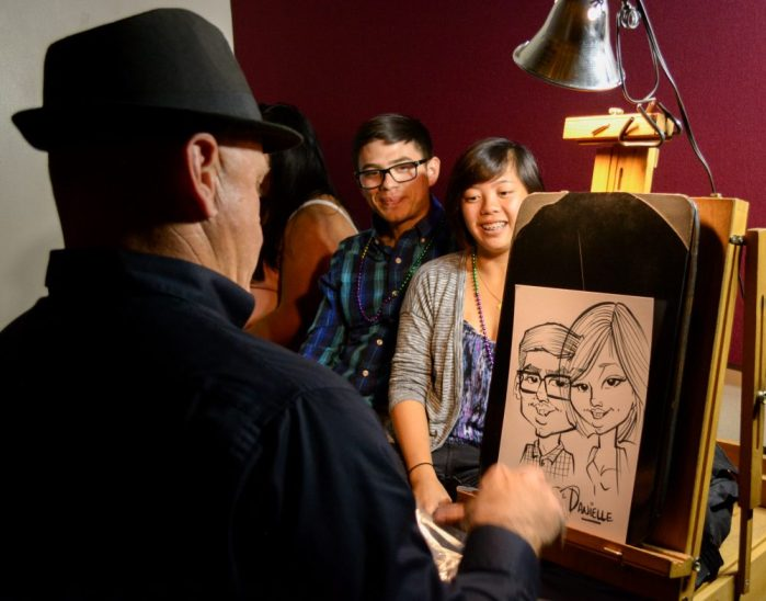 Students get caricatures drawn of themselves