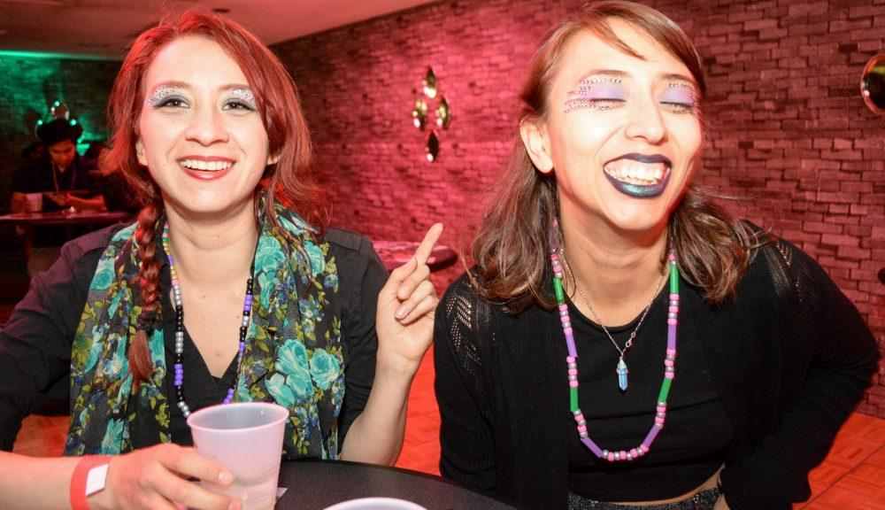 Two female students wear sparkly makeup
