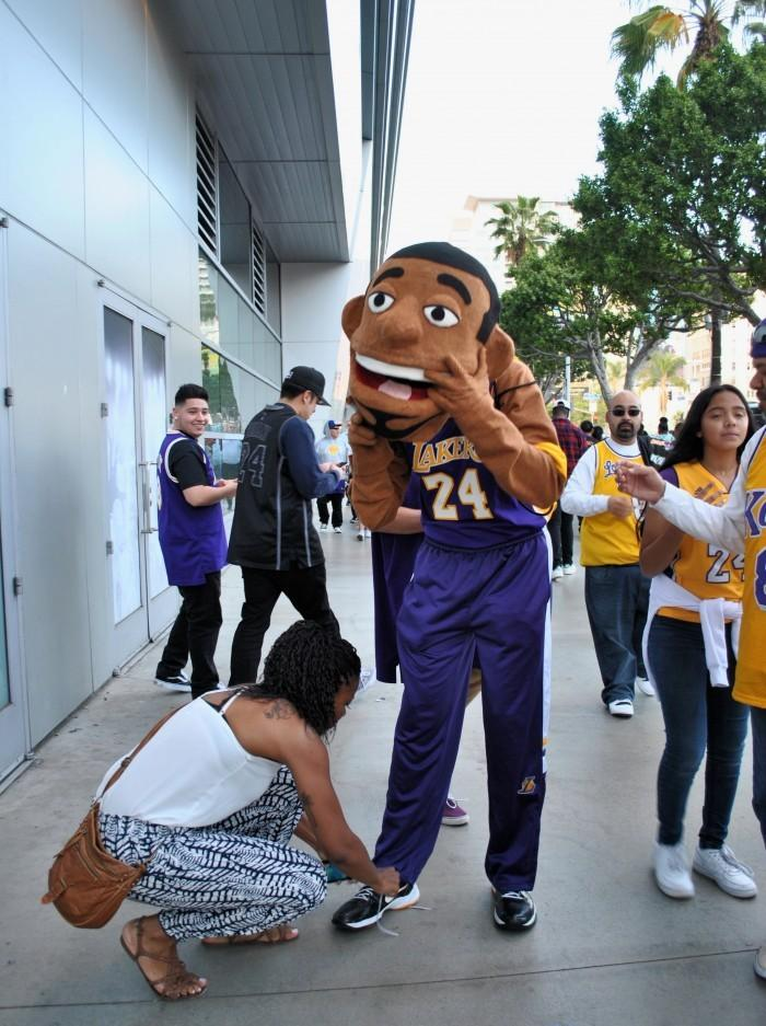 Fan wears character suit with Lakers uniform