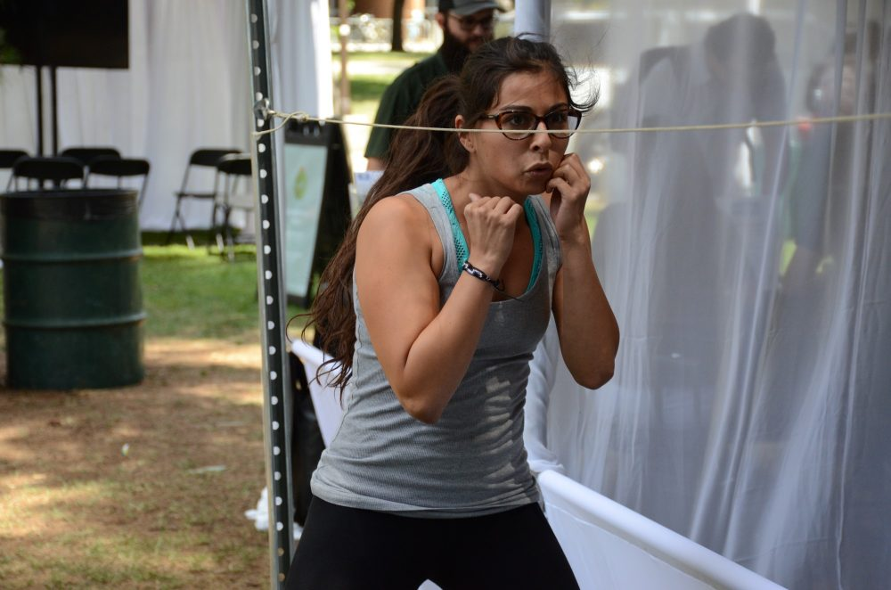 A woman works out on dip lines