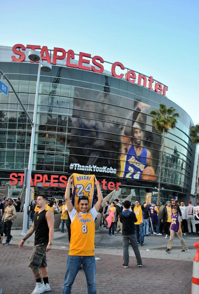Man carries Kobe Bryant jersey outside of Staples Center